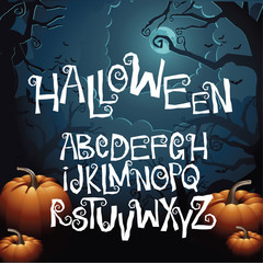 Halloween hand drawn creepy curly font alphabet with bonus jack-o-lantern and scary tree background. EPS 10 vector.