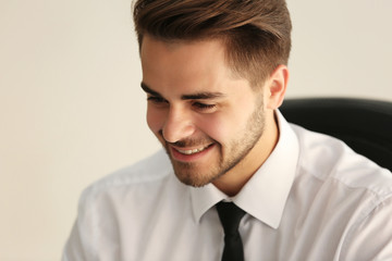 Handsome young man working at office