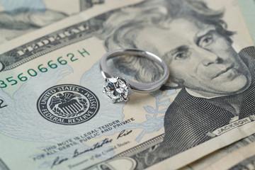 diamond ring on money