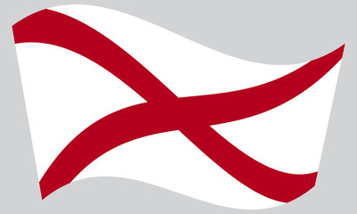 Flag of Alabama waving on gray background