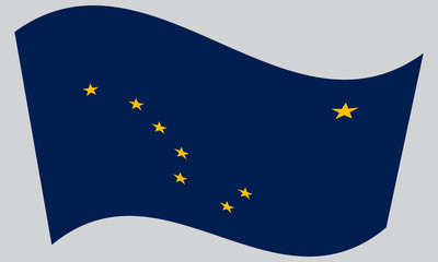 Flag of Alaska waving on gray background