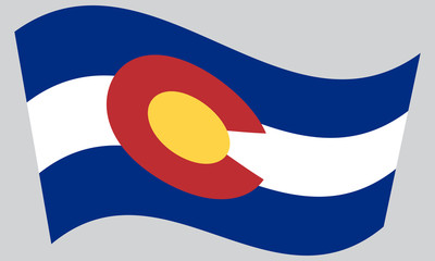 Flag of Colorado waving on gray background