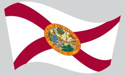 Flag of Florida waving on gray background