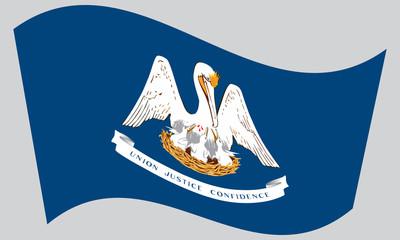 Flag of Louisiana waving on gray background
