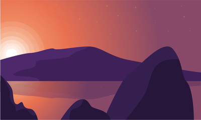 Silhouette of rock and lake landscape