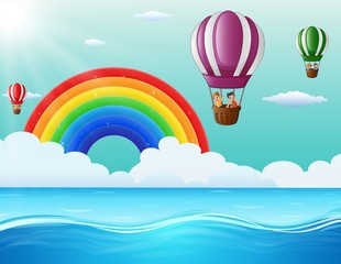 Happy cartoon kids flying in a hot air balloon in ocean