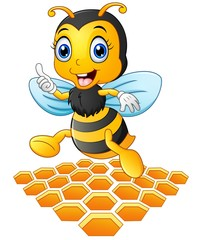 Smiling cartoon bee with a honeycomb