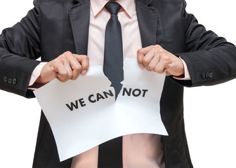 Businessman ripping up the we can not sign on white background