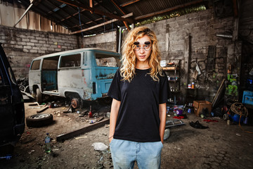 urban style girl in a grunge garage