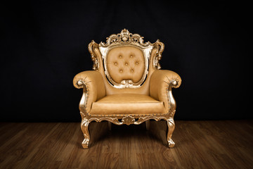 Antique armchair / throne with golden ornaments