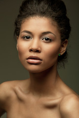 Fototapete - Fashionable portrait of an extraordinary beautiful naked african american female model with perfect smooth glowing mulatto skin and full lips, studio shoot