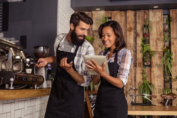 Waiter and waitresses using laptop while working