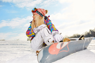 blonde snowboarder girl on snow