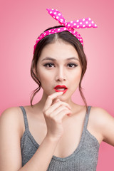 Portrait of beautiful pinup asian woman with vintage makeup and