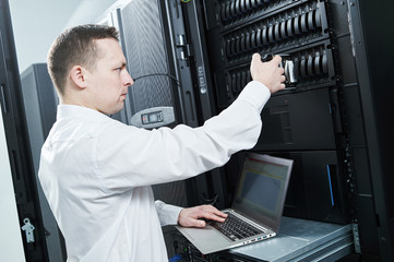 Storage maintenance. Service engineer in server room