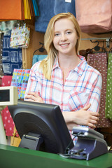 Female Cashier At Sales Desk Of Store
