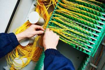 internet connection. engineer connecting fiber optic cables