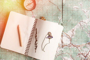 wanderlust and adventure concept, compass and notebook with wild