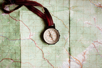 wanderlust and explore concept, compass on map, top view, vintag