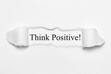 Think Positive! on white torn paper