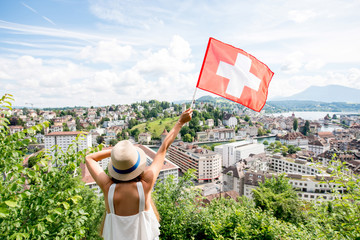 Young female traveler enjoying great view on Lucerne cityscape in Switzerland Wall mural