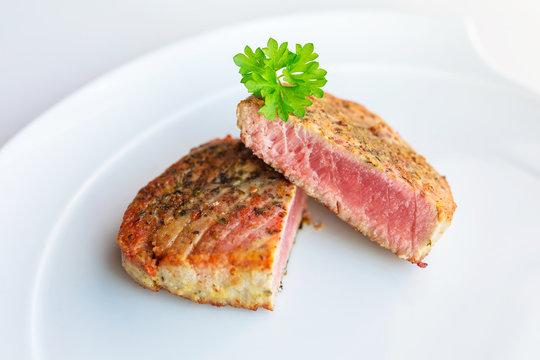 Medium cooked tuna steak on the plate