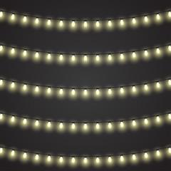 Vector set of garlands light on a black background
