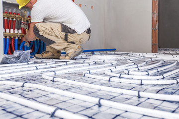 Pipefitter mounted underfloor heating. Heating system and underfloor heating.