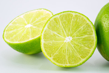 slice of fresh lime on white background