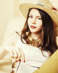 pretty young woman wearing sunglasses and summer hat, fashion li