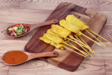 "Charcoal boiled pork satay, home made in big size, served with Thai cucumber chili sauce as "" Ar Jad"" and nut sauce are popular Asia cuisine."