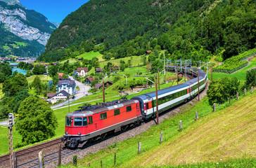 Intercity train climbs up the Gotthard railway - Switzerland