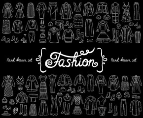 Vector set with hand drawn isolated doodles on the theme of fashion on black color