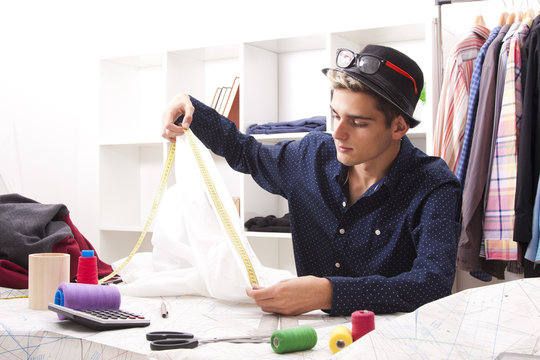 man working in the textile workshop
