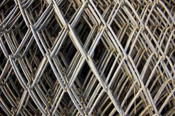 Closeup of a calvanized mesh fence roll