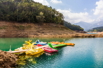 Colorful paddleboats on the reservoir (Spain)