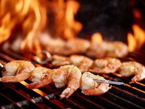 grilling shrimp on skewer on grill
