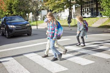 school children crossing the street