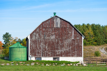 Old wooden barn and metal silo