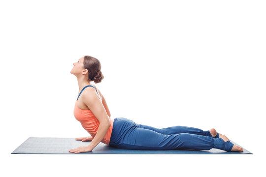 Sporty fit yogini woman practices yoga asana bhujangasana
