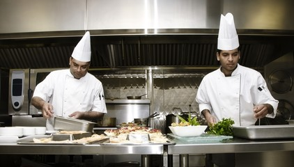 Two Chefs In Industrial Kitchen