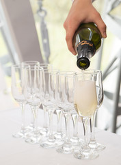 Pouring champagne, glasses. Alcohol, luxury event