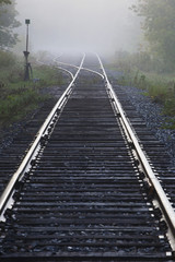 Railway Track In The Early Morning Mist; Ville De Lac Brome, Quebec, Canada