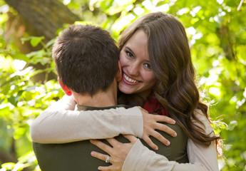 Newlywed Couple Embracing In A Park; Edmonton, Alberta, Canada