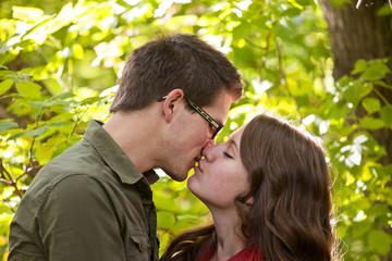 Newlywed Couple Kissing In The Park; Edmonton, Alberta, Canada