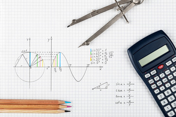 Mathematics concept, sine function - calculator, compass and coloring pencils