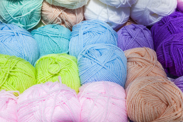 Balls of coloured knitting wool.