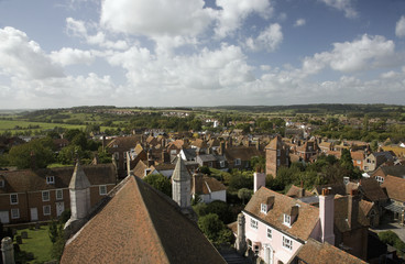 Buildings With Tiled Roofs And Pastures In The Distance; Rye, Sussex, England
