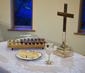 Communion Emblems Set Up On A Table With A Cross; Sheffield, South Yorkshire, England