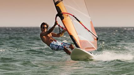 A Man Windsurfing; Tarifa, Cadiz, Andalusia, Spain